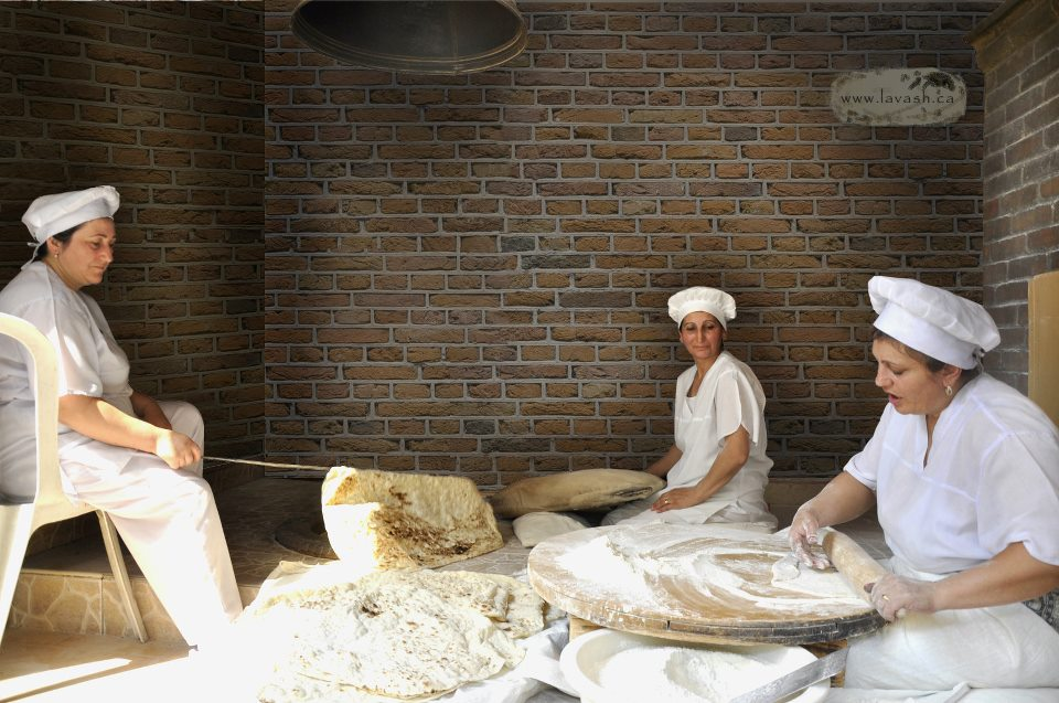 Armenian women are baking lavash in the old‐style bakery in Yerevan